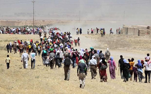 Yazidi people fleeing ISIS