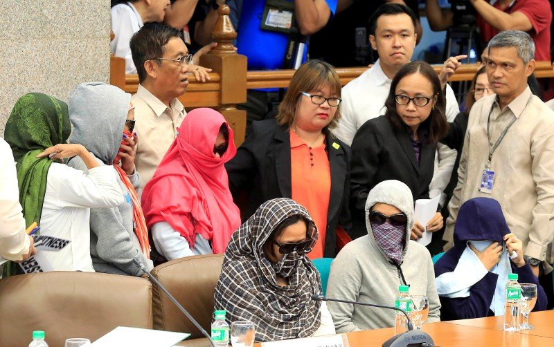 Women want to know why their children are being murdered. Here they gather at a Senate Whitewash Hearing