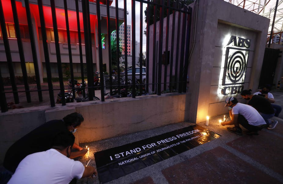 A vigil outside the offices of ABS-CBN after it was forced off air on May 5. Rolex Dela Pena/EPA